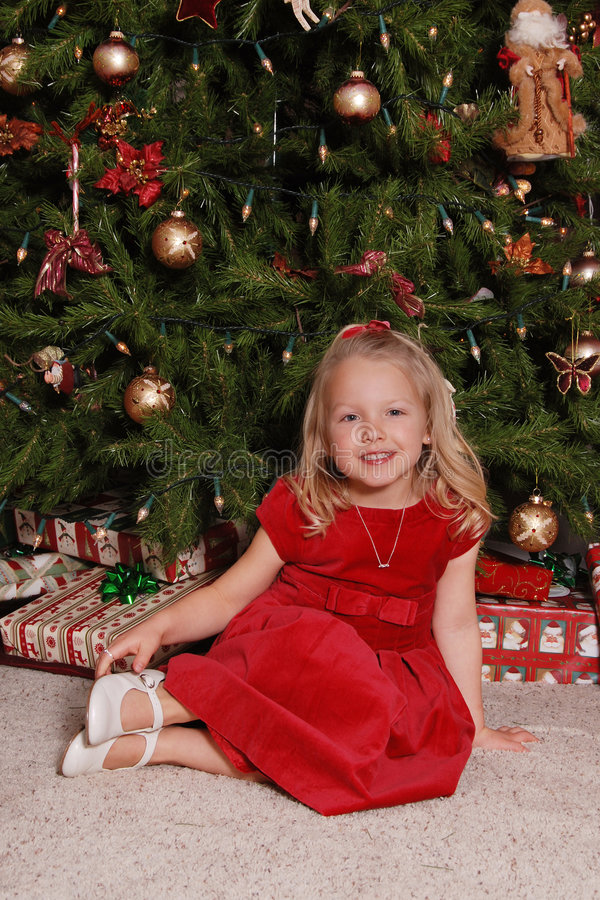 Little Girl By Christmas Tree. Royalty Free Stock Photos