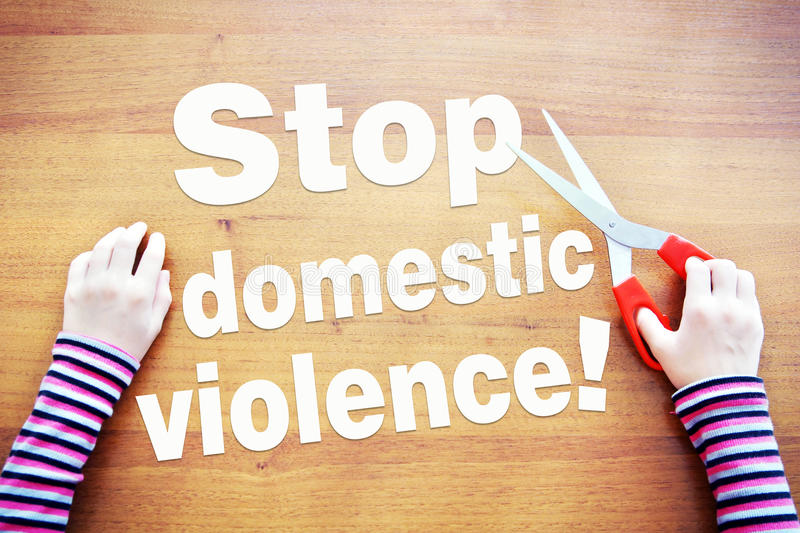Little girl claims to stop domestic violence. Concept of cruelty to children royalty free stock photo