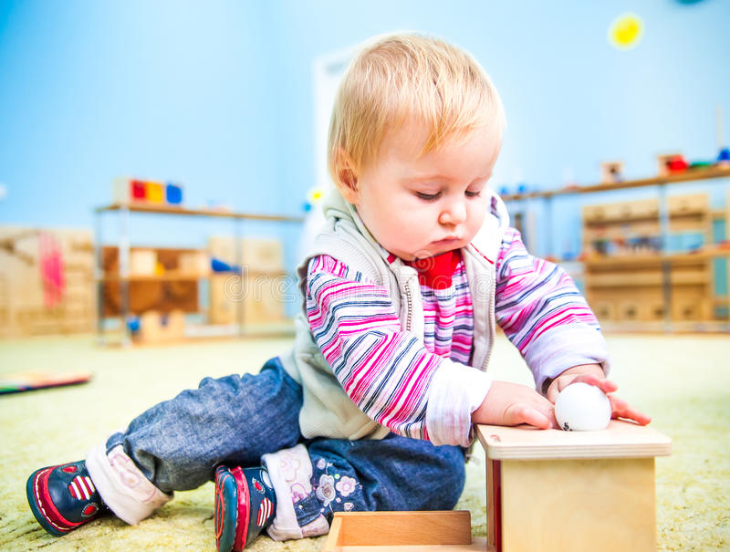 Little girl in the classroom early development stock photo