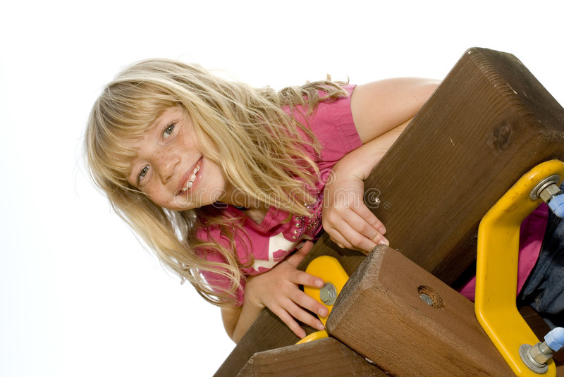 Little girl climbing a playset royalty free stock images