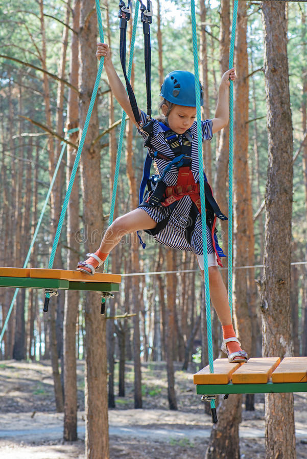 Download Little Girl Climbs On Rope Harness Royalty Free Stock Photo - Image: 33685335