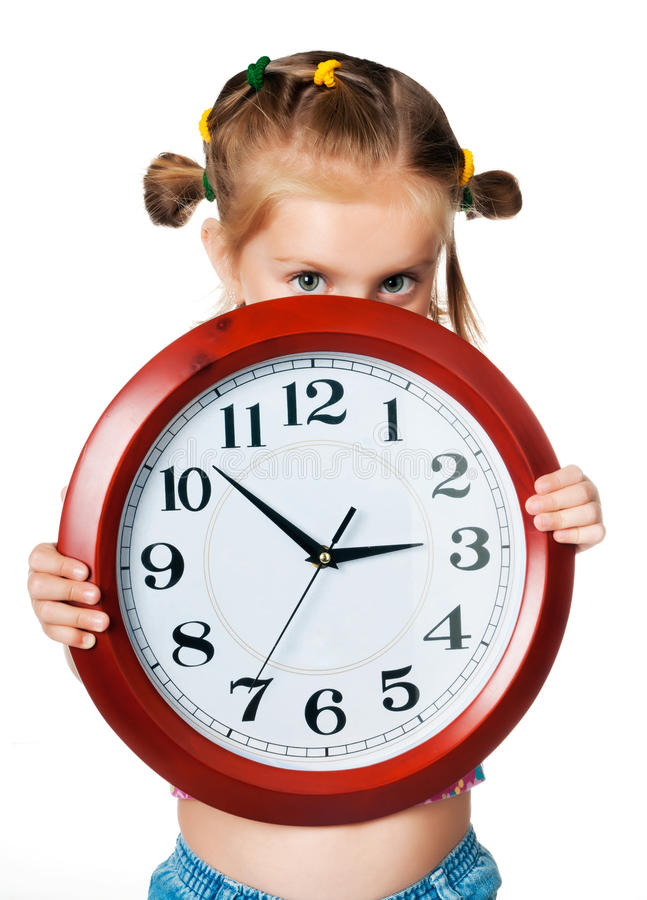 Little girl with clock. Little pretty girl with red big clock stock photos