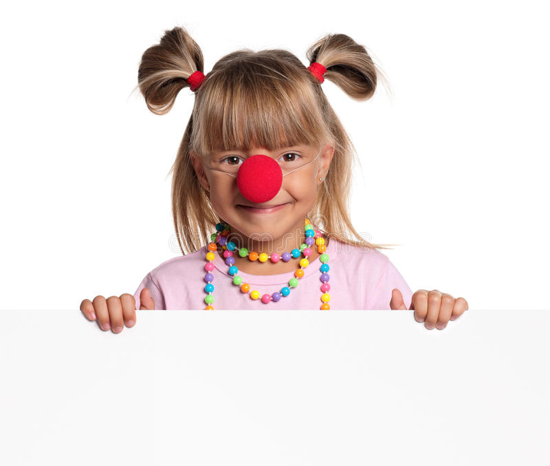 Little girl with clown nose. Portrait of happy little girl with red clown nose with white blank royalty free stock images