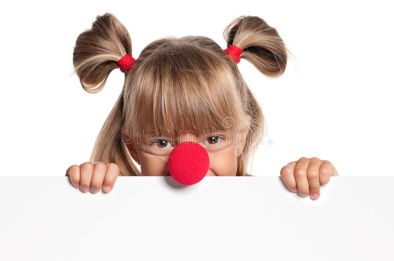 Little girl with clown nose. Portrait of happy little girl with red clown nose with white blank stock image
