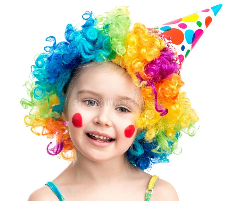 Little girl in clown wig isolated on a white background royalty free stock photos