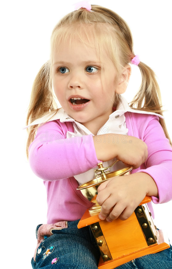 Little Girl And A Coffee Grinder Stock Photo