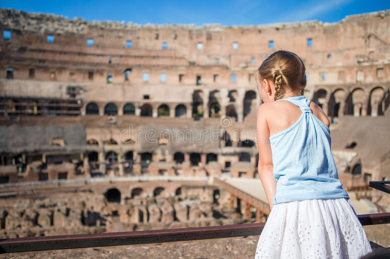 Little girl in Coliseum, Rome, Italy. Back view of kid looking at famous places in Europe stock photography
