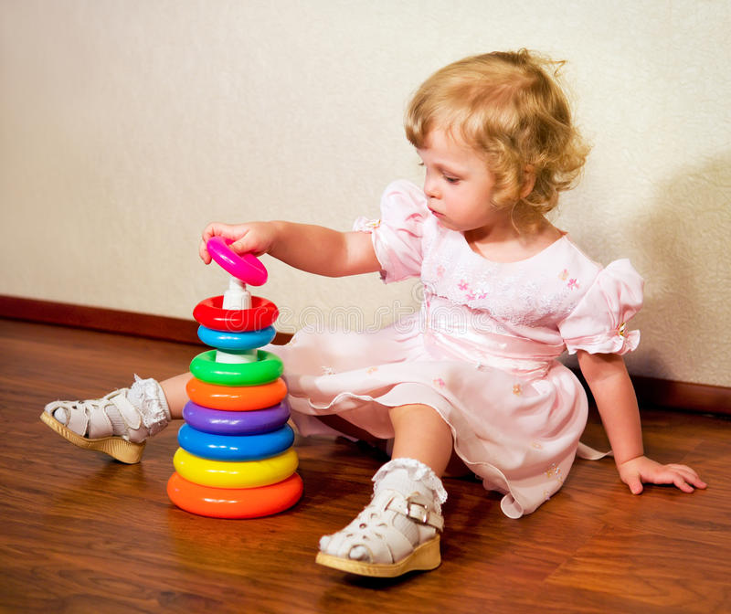 Download Little Girl Collects Pyramid Royalty Free Stock Photography - Image: 33244807