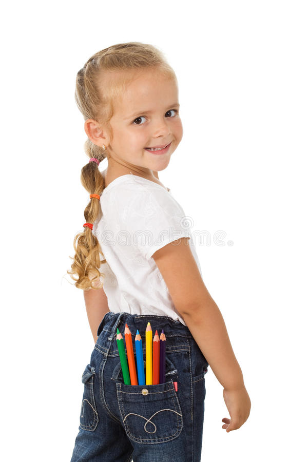 Little girl with colored pencils in back pocket