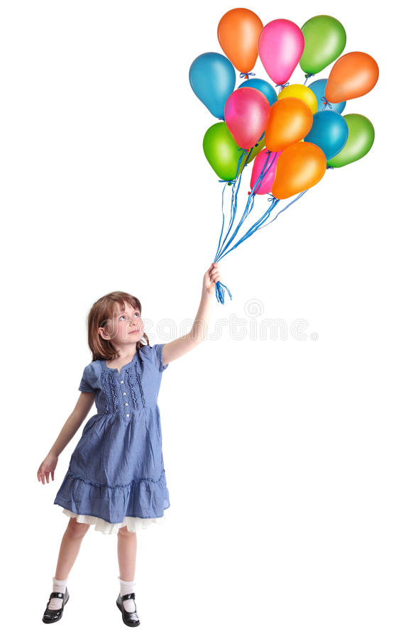 Little girl with colorful balloons stock photo