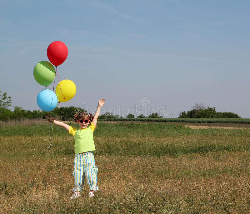 Download Little Girl With Colorful Balloons Royalty Free Stock Photos - Image: 26267598