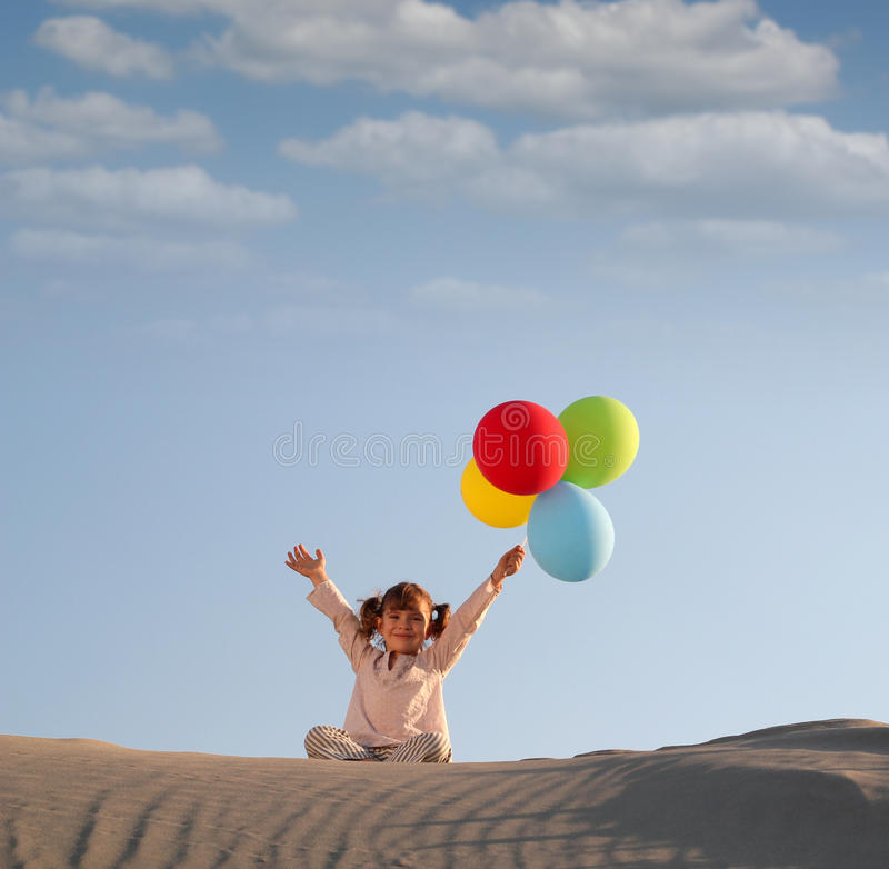Download Little Girl With Colorful Balloons Stock Photo - Image: 27196556