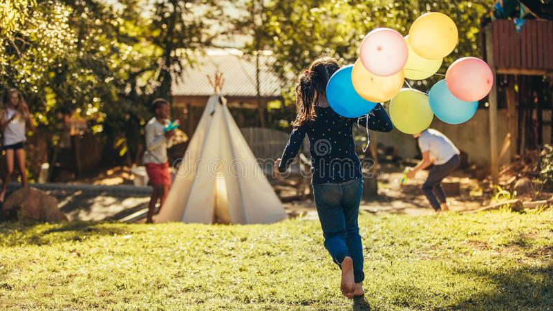 Children playing together in backyard royalty free stock images