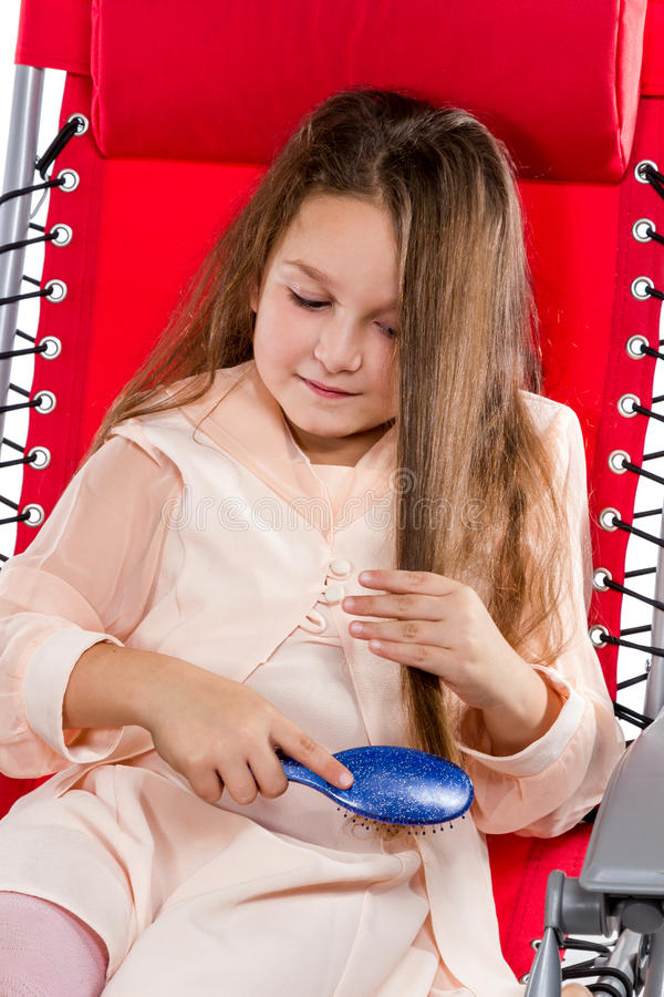Little girl combing royalty free stock image