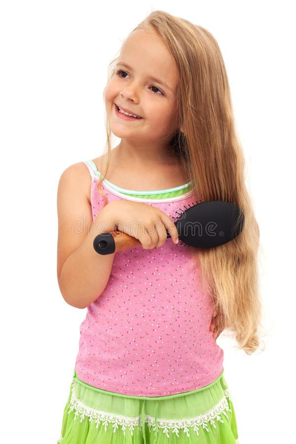 Little girl combing hair royalty free stock photo