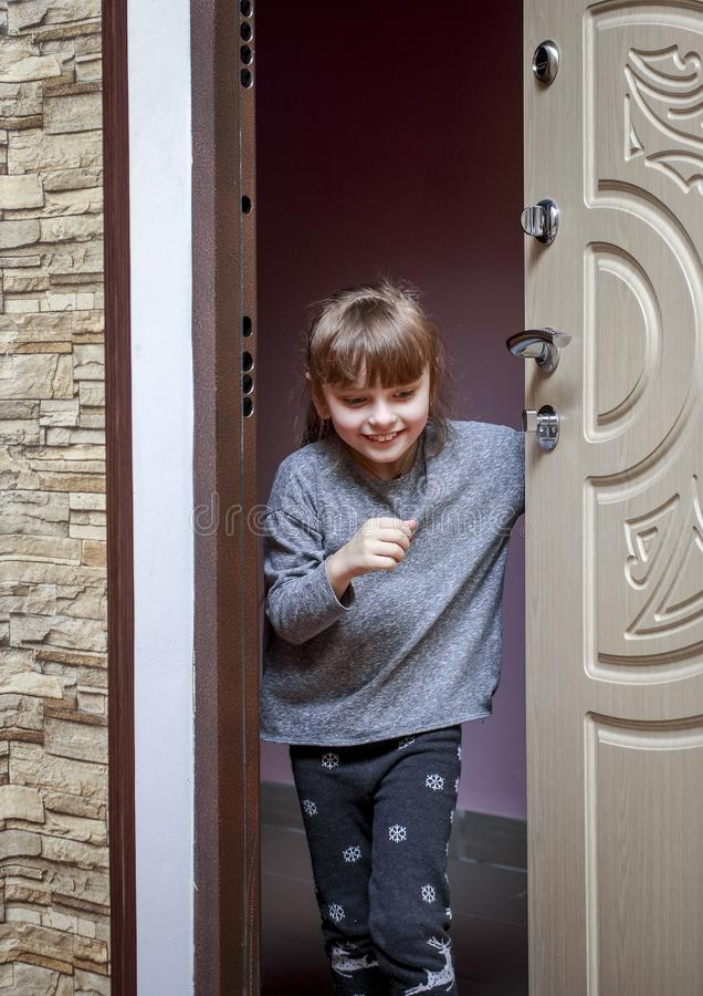 Download The Little Girl Comes Home From The Landing And Closes The Door Stock Image -  sc 1 st  Dreamstime.com & The Little Girl Comes Home From The Landing And Closes The Door ...