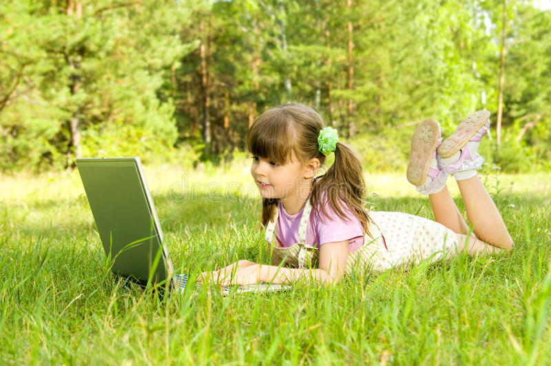 Download Little girl with computer stock photo. Image of horizontal - 10389000