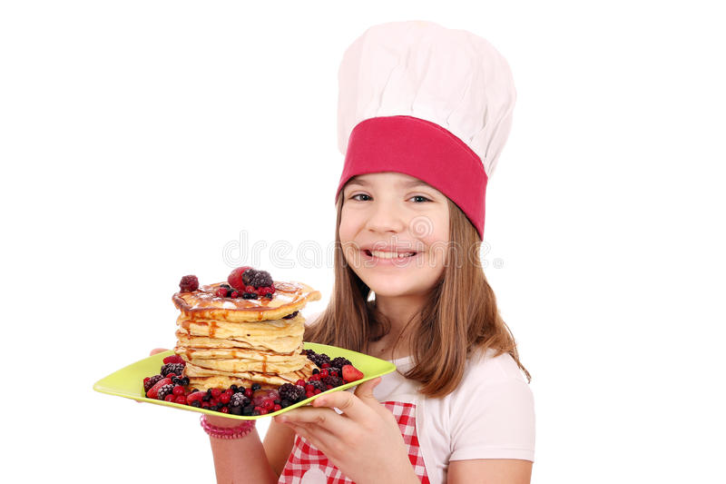 Little girl cook with sweet pancakes. Happy little girl cook with sweet pancakes stock images