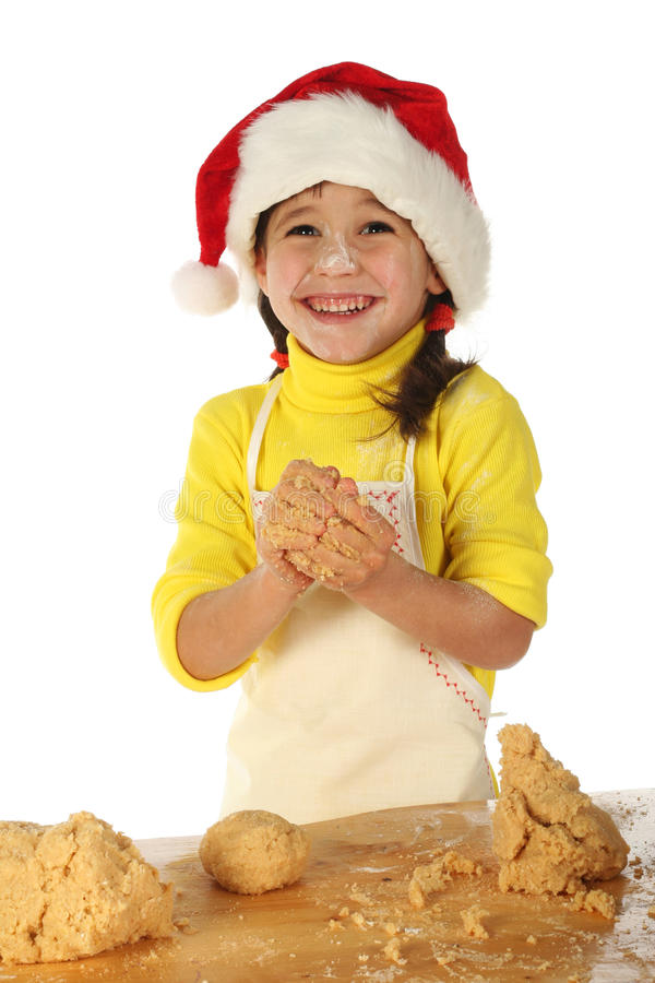 Little girl cooking the Christmas cake royalty free stock photo
