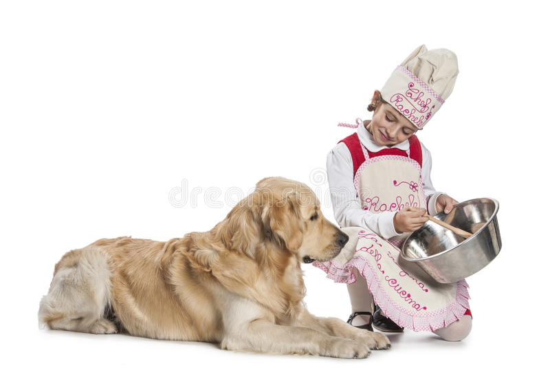 Little girl cooking for her dog