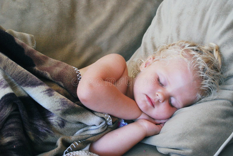 Little girl on couch royalty free stock photos