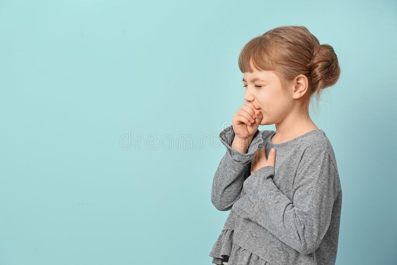 Little girl coughing royalty free stock photo