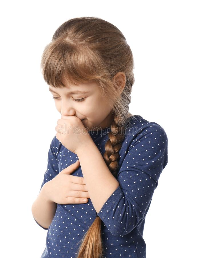 Little girl coughing. On white background stock photos