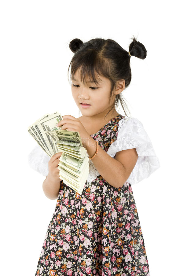 Little girl counting money royalty free stock images