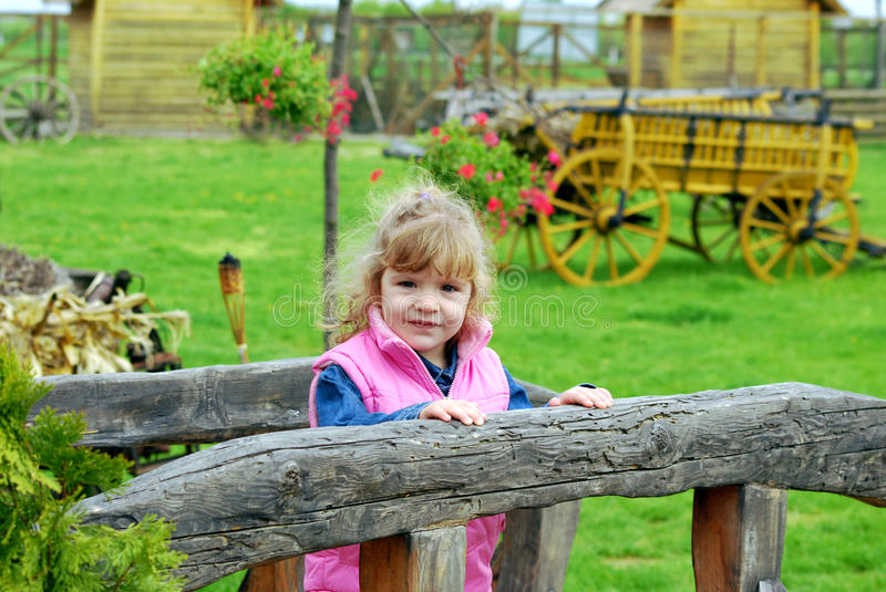 Little girl on the country stock photo