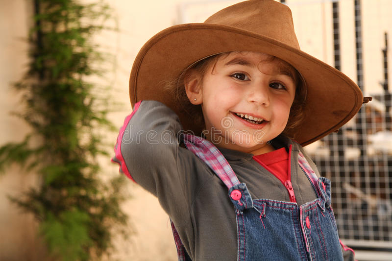 Little girl with a cowboy hat stock images