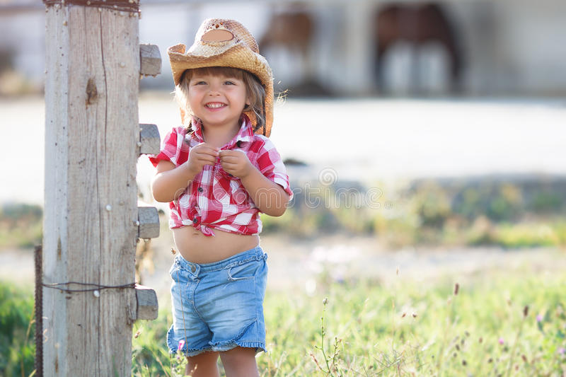 The little girl in the cowboy hat in the summer countryside stock photos