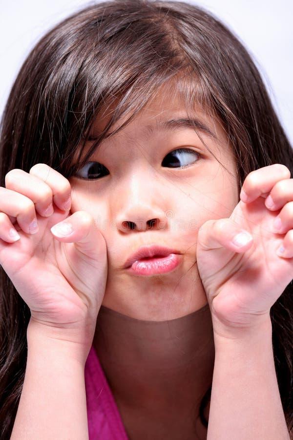 Little girl crossing eyes royalty free stock photos