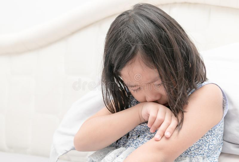 Little girl crying on bed, sad and angry royalty free stock photography