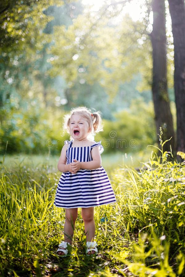 Little girl crying. stock photos