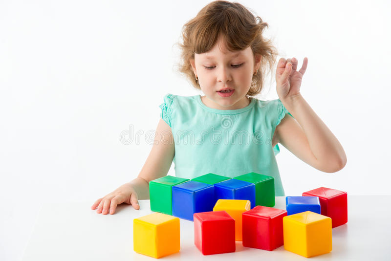 Little girl with cubes stock photos