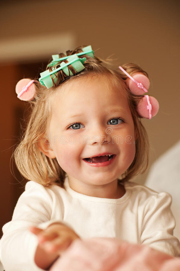 Little girl with curlers royalty free stock image