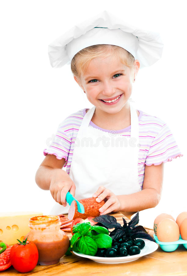 Download Little girl cuting sausage stock image. Image of adorable - 26459303