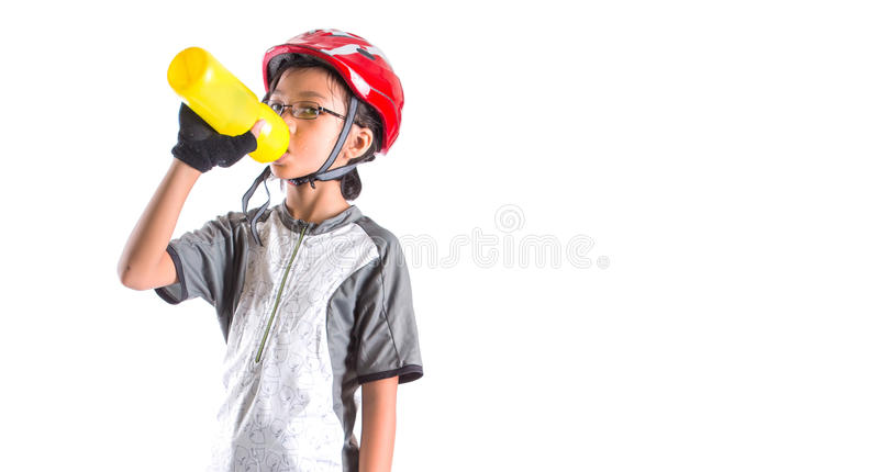Little Girl With Cycling Attire Drinking I royalty free stock photos