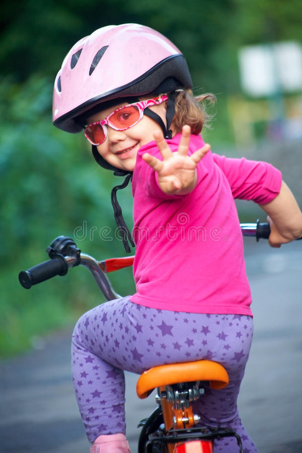 Little girl cyclist royalty free stock photo