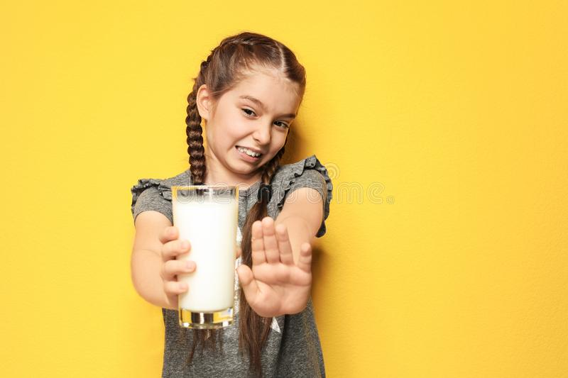 Little girl with dairy allergy holding glass of milk royalty free stock photography