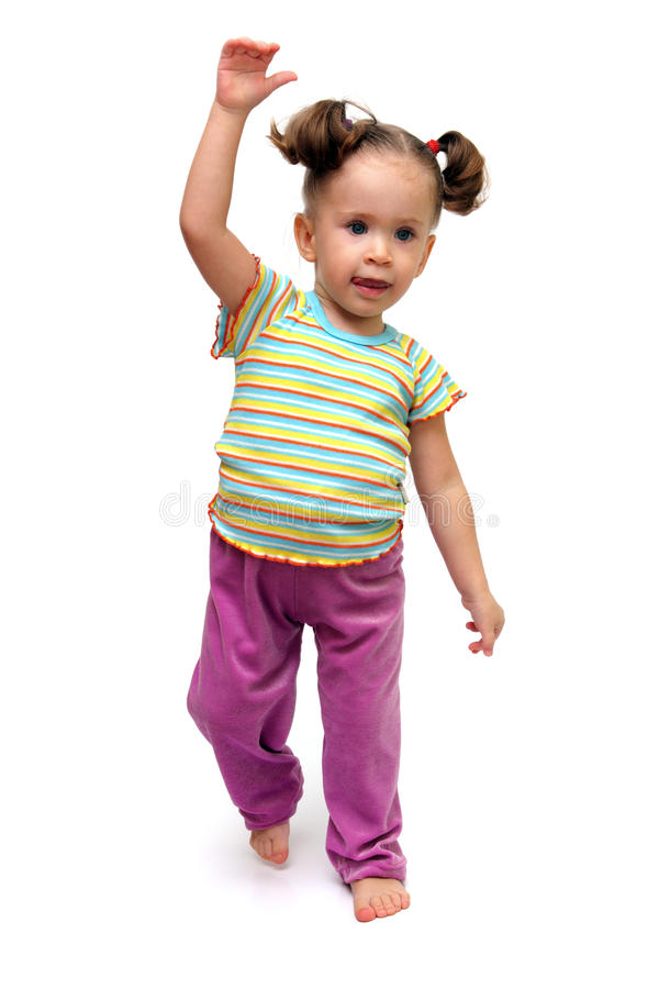 Little girl dancing. Cute little girl dancing on white background royalty free stock photography