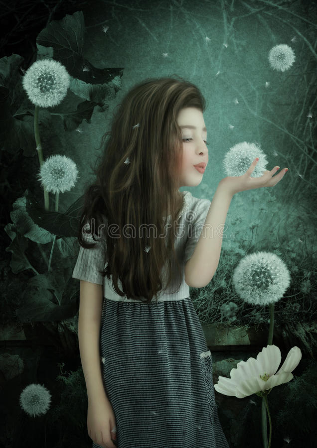 Little girl with dandelion royalty free stock image