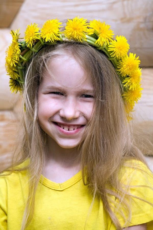 Little girl in dandelion crown royalty free stock image