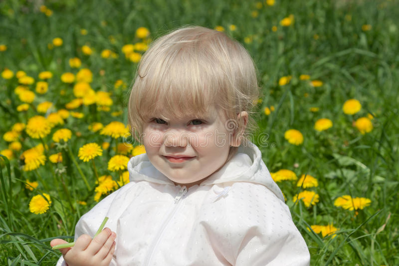 Download Little Girl With Dandelions Stock Photo - Image: 18316928