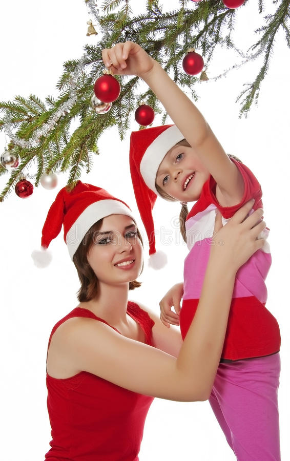 Download Little Girl Decorate A Christmas Tree Stock Image - Image: 27026875
