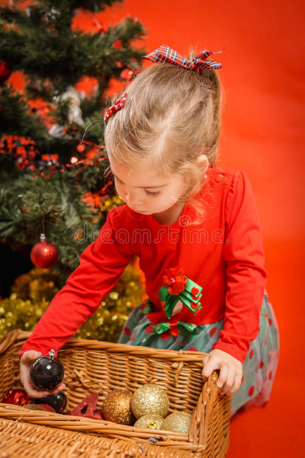 Little girl decorates the Christmas tree royalty free stock photos