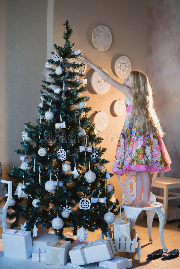 Little girl decorates the Christmas tree toys, the joy, the preparation for the holiday, packaging, boxes, Christmas, New Year, li stock images
