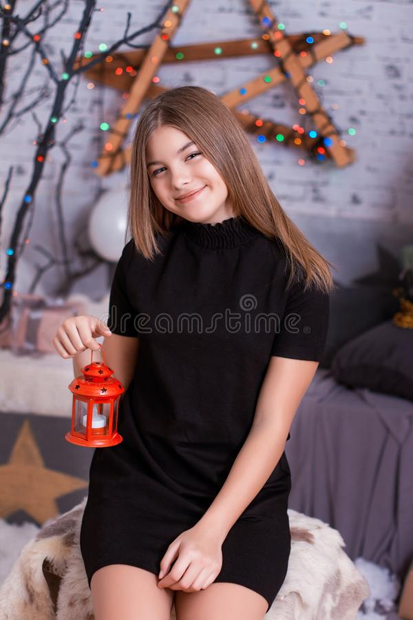 Little girl with decorative vintage lamp stock photos