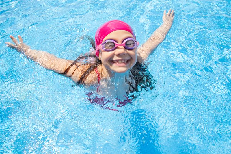 Girl swim in  pool stock photo