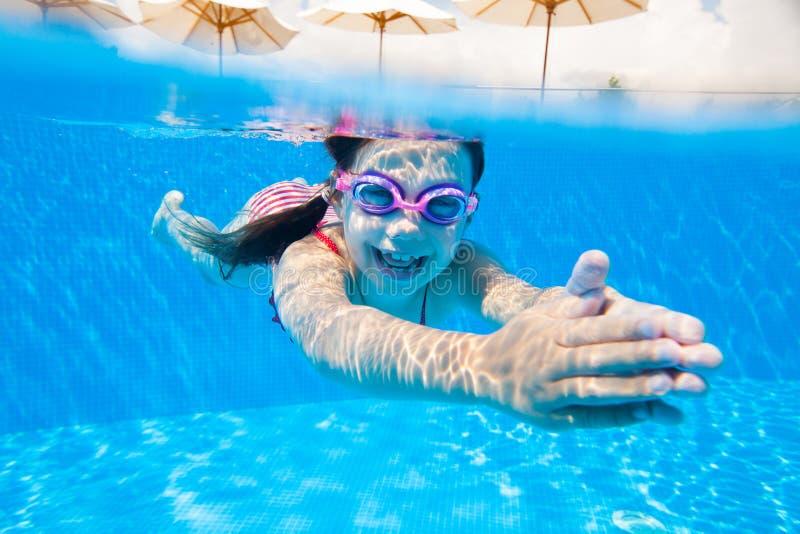 Girl swim in  pool royalty free stock images